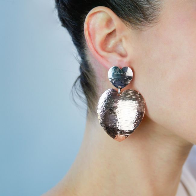 Diamond cut heart-shaped earrings